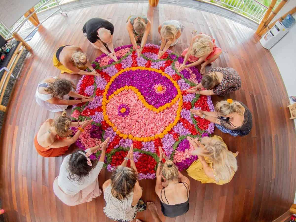 yoga teacher training students around a mandala
