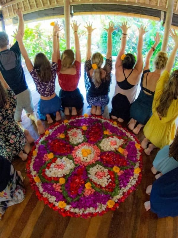 Yoga teacher training students doin fire toes aroung a mandala