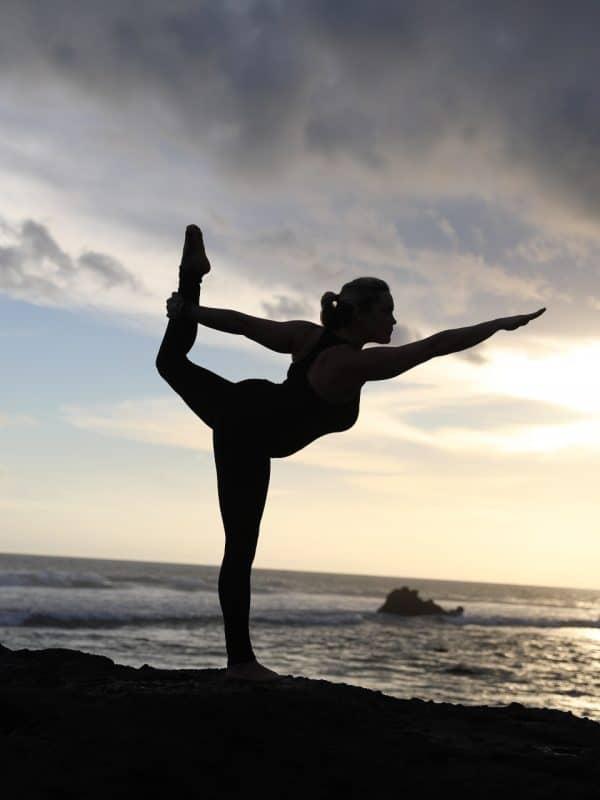 dancers pose along the beach in Bali
