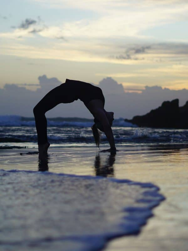 Wheel pose on the beach