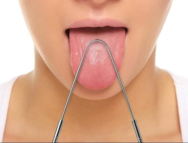 tongue scraping, cleaning the tongue