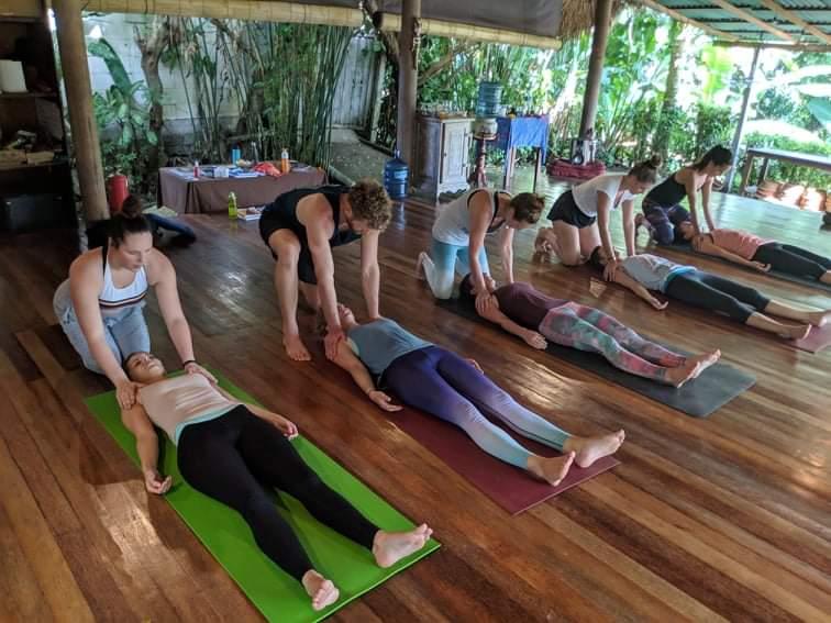 Yoga students in Savasana